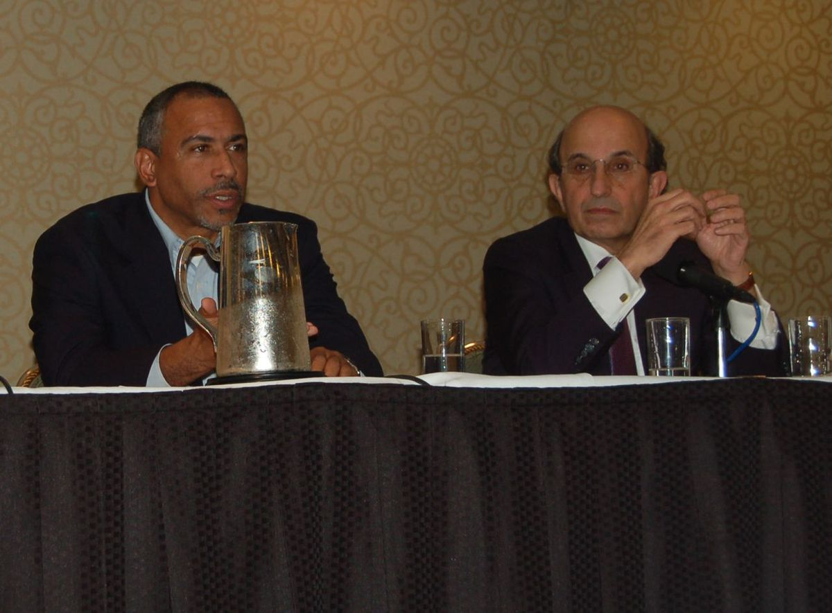 Chancellor Klein, right, with Pedro Noguera at a panel discussion today