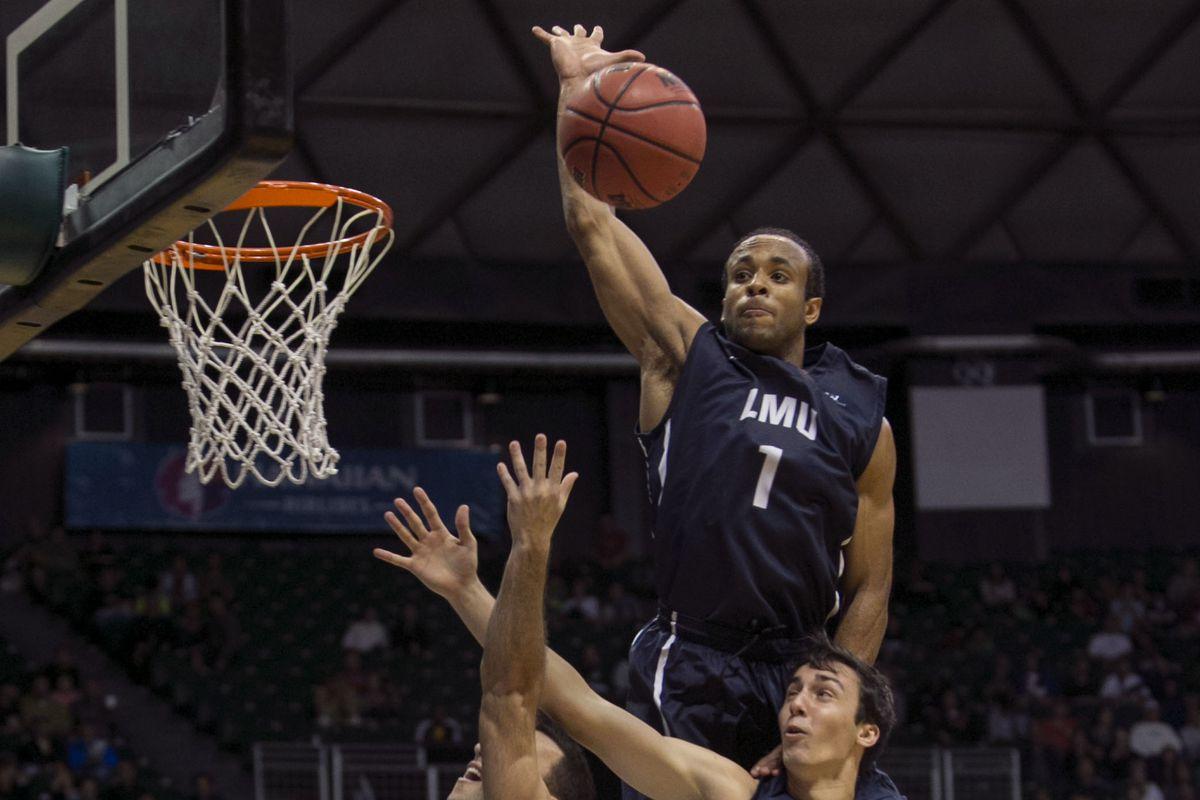 Evan Payne blocks a shot against Wichita State
