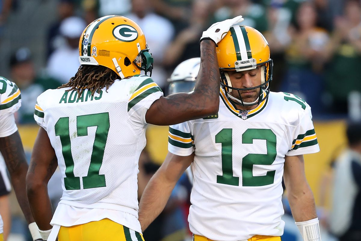 Davante Adams congratulates Aaron Rodgers of the Green Bay Packers after scoring a two-point conversion during the second half of a game against the Los Angeles Chargers at Dignity Health Sports Park on November 03, 2019 in Carson, California.