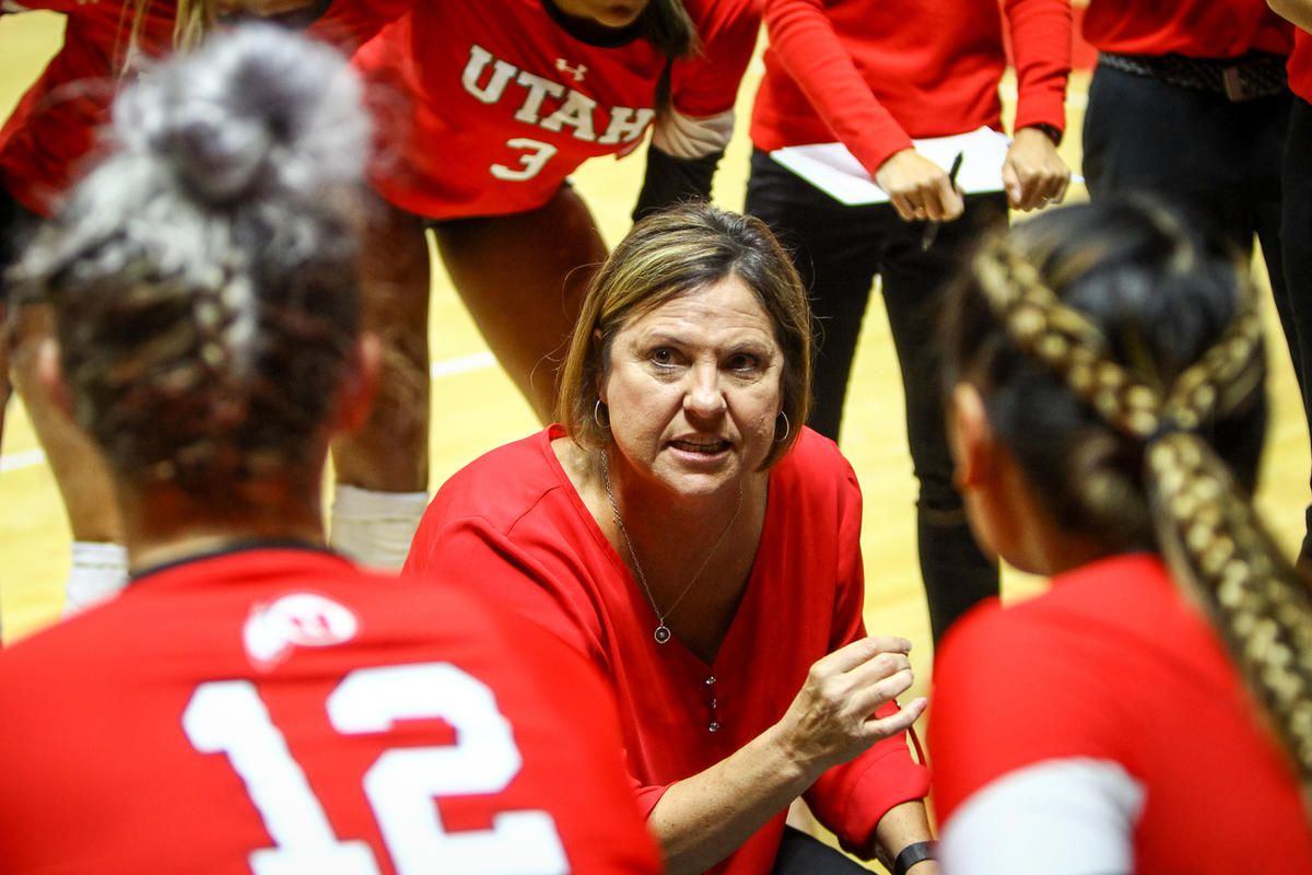 Utah volleyball coach Beth Launiere talks with her players during match against BYU at the Huntsman Center in Salt Lake City on Thursday, Sept. 14, 2017.