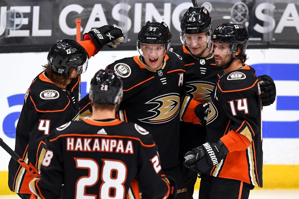 Anaheim Ducks right wing Jakob Silfverberg (33) is congratulated by Anaheim Ducks defenseman Cam Fowler (4), defenseman Jani Hakanpaa (28), center Adam Henrique (14) and center Danton Heinen (43) after scoring a goal in the first period of the game against the Colorado Avalanche at Honda Center.