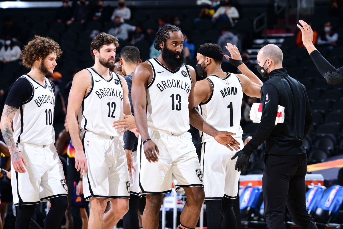 James Harden #13 of the Brooklyn Nets hi-fives his teammates during the game against the Phoenix Suns on February 16, 2021 at Talking Stick Resort Arena in Phoenix, Arizona.