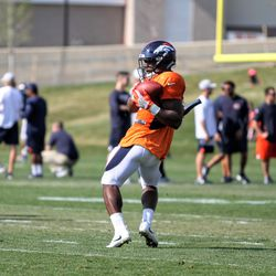 Broncos rookie RB Royce Freeman makes a back-shoulder catch during drills at training camp.