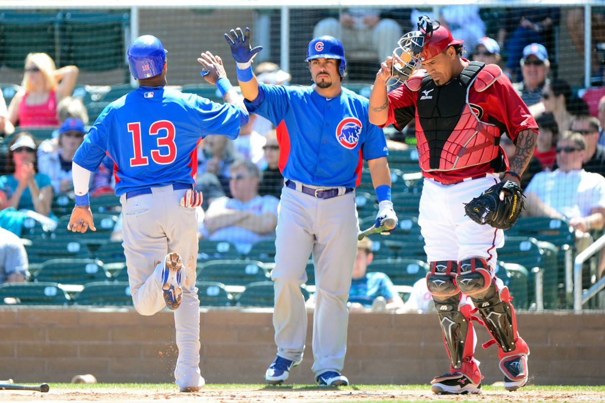 Scottsdale, AZ, USA; Chicago Cubs shortstop Starlin Castro is congratulated by catcher Geovany Soto after scoring a run in the first inning against the Arizona Diamondbacks at Salt River Fields. Credit: Matt Kartozian-US PRESSWIRE