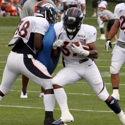 Fourth year RB Jeremiah Johnson lays into rookie RB Montee Ball