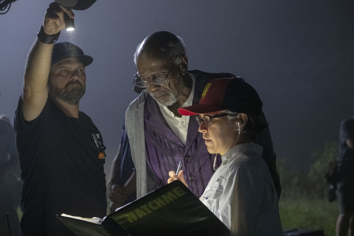 Louis Gossett, Jr., and Nicole Kassell behind the scenes of Watchmen