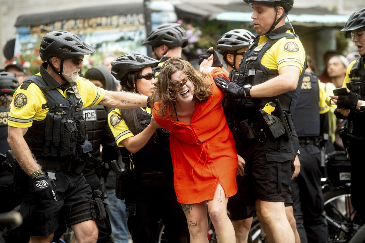 """Police officers detain a protester against right-wing demonstrators following an """"End Domestic Terrorism"""" rally in Portland, Ore., on Saturday, Aug. 17, 2019. Although the main protest remained largely peaceful, some skirmishes erupted in the following ho"""