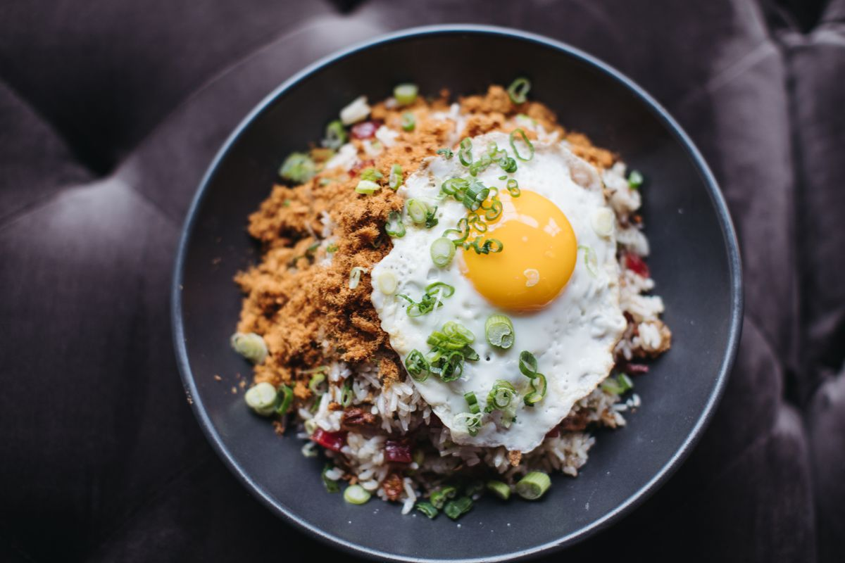 bowl of rice with scallions and egg