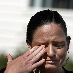Neighbor Angela Moffo speaks to reporters in West Point on Thursday, May 23, 2013. Two young brothers were found dead in their West Point home late Wednesday. Their 15-year-old brother was booked into the Farmington Bay Youth Detention Center Thursday in connection with the deaths.
