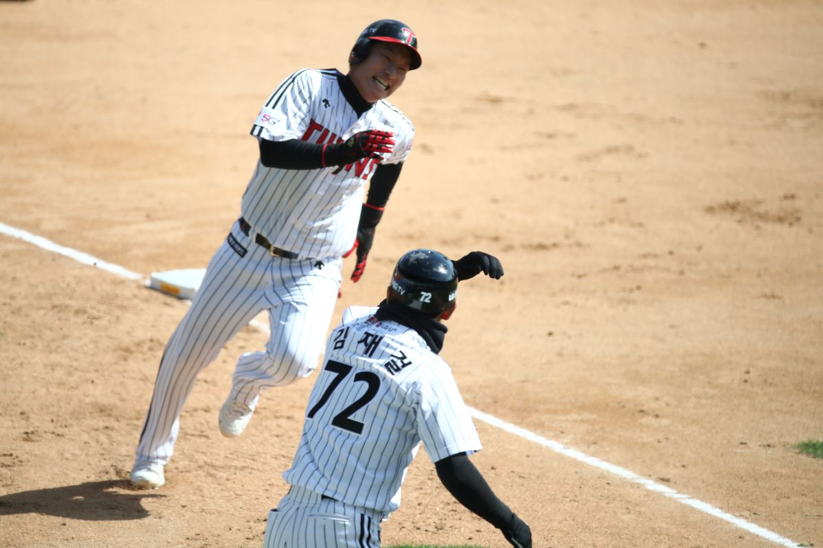 Kim Ho-eun of LG Twins slides safely into the home plate during the preseason game between LG Twins and Doosan Bears at Jamsil Baseball Stadium on April 21, 2020 in Seoul, South Korea.
