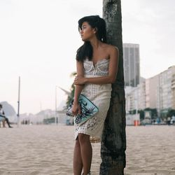 """Olivia of <a href=""""http://lusttforlife.com""""target=""""_blank"""">Lust for Life</a> is wearing a For Love & Lemons bralette, a Sea New York skirt, a Bikini Bird clutch and a Vanessa Mooney earring."""