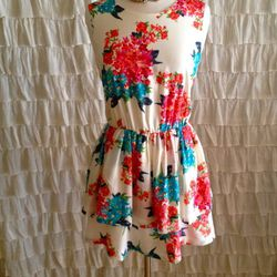 Ivory Floral Mini Dress by Lucca Couture, $70; Fox and Chain Necklace by Bones & Feathers Collective, $120