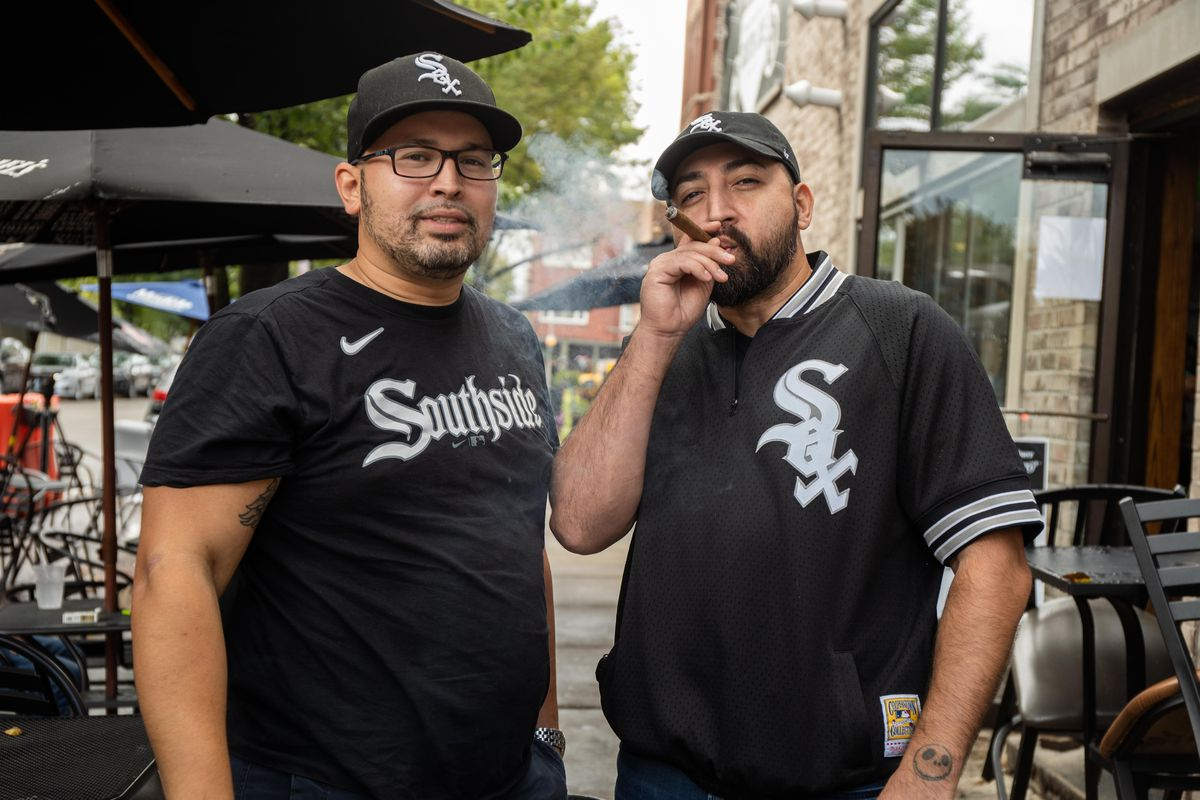 Sox fans Anthony Rodriguez, left, and Hector Roldan, right, pose for a picture in the Bridgeport neighborhood before the first game of the American League Division Series between the Chicago White Sox and Houston Astros, Thursday afternoon, October 7, 2021.   Pat Nabong/Sun-Times