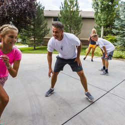 Kurt Christensen plays basketball with his children, Elle, 13, left, McCall, 18, and Adam, 15, at their home in Cottonwood Heights on Wednesday, Aug. 12, 2015.