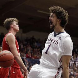 Saint Mary's center Jordan Hunter (1) reacts after dunking against Utah during the second half of an NCAA college basketball game in the quarterfinals of the NIT, Wednesday, March 21, 2018, in Moraga, Calif. (AP Photo/Marcio Jose Sanchez)