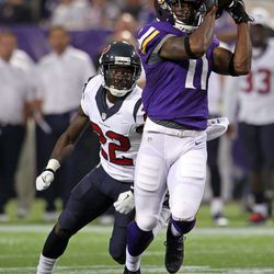 Aug 9, 2013; Minneapolis, MN, USA; Minnesota Vikings wide receiver Stephen Burton (11) catches a pass during the first quarter against the Houston Texans at the Metrodome.