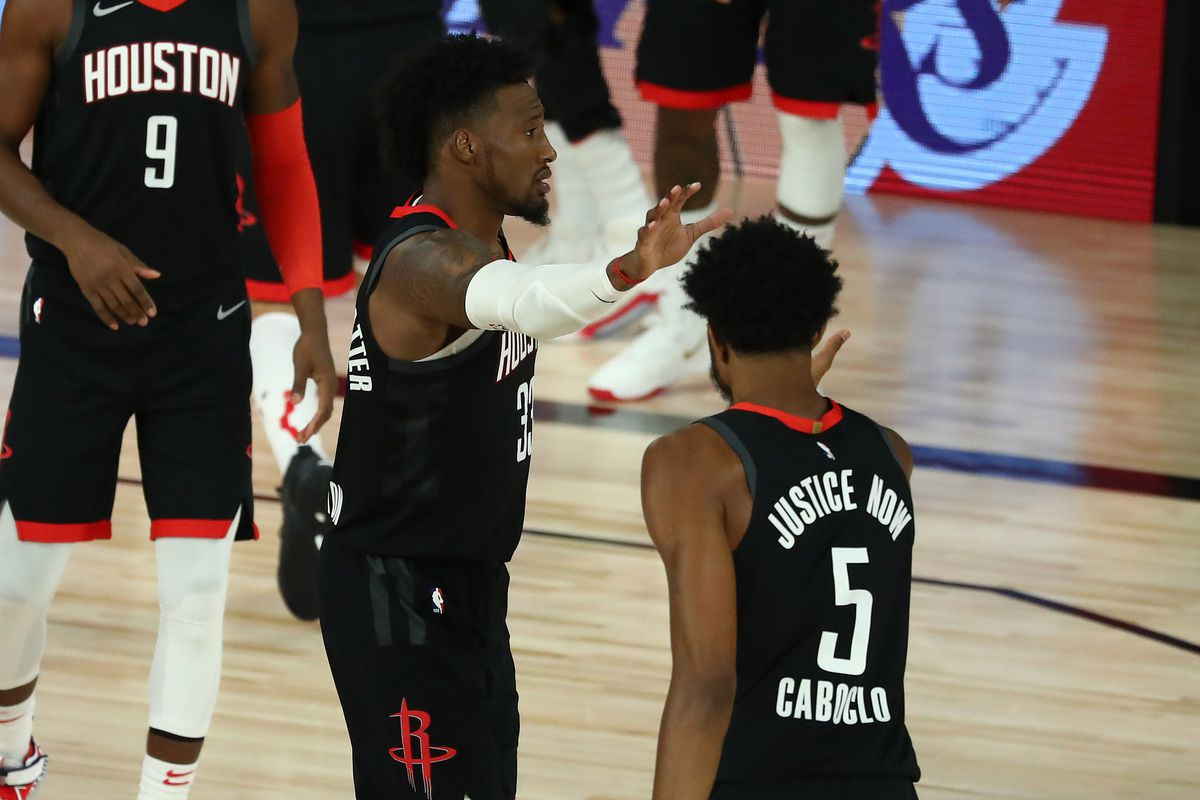 Robert Covington and Bruno Caboclo of the Houston Rockets celebrate after defeating the Oklahoma City Thunder in Game One of the 2020 NBA Playoffs at the Field House at the ESPN Wide World Of Sports Complex on August 18, 2020 in Lake Buena Vista, Florida.