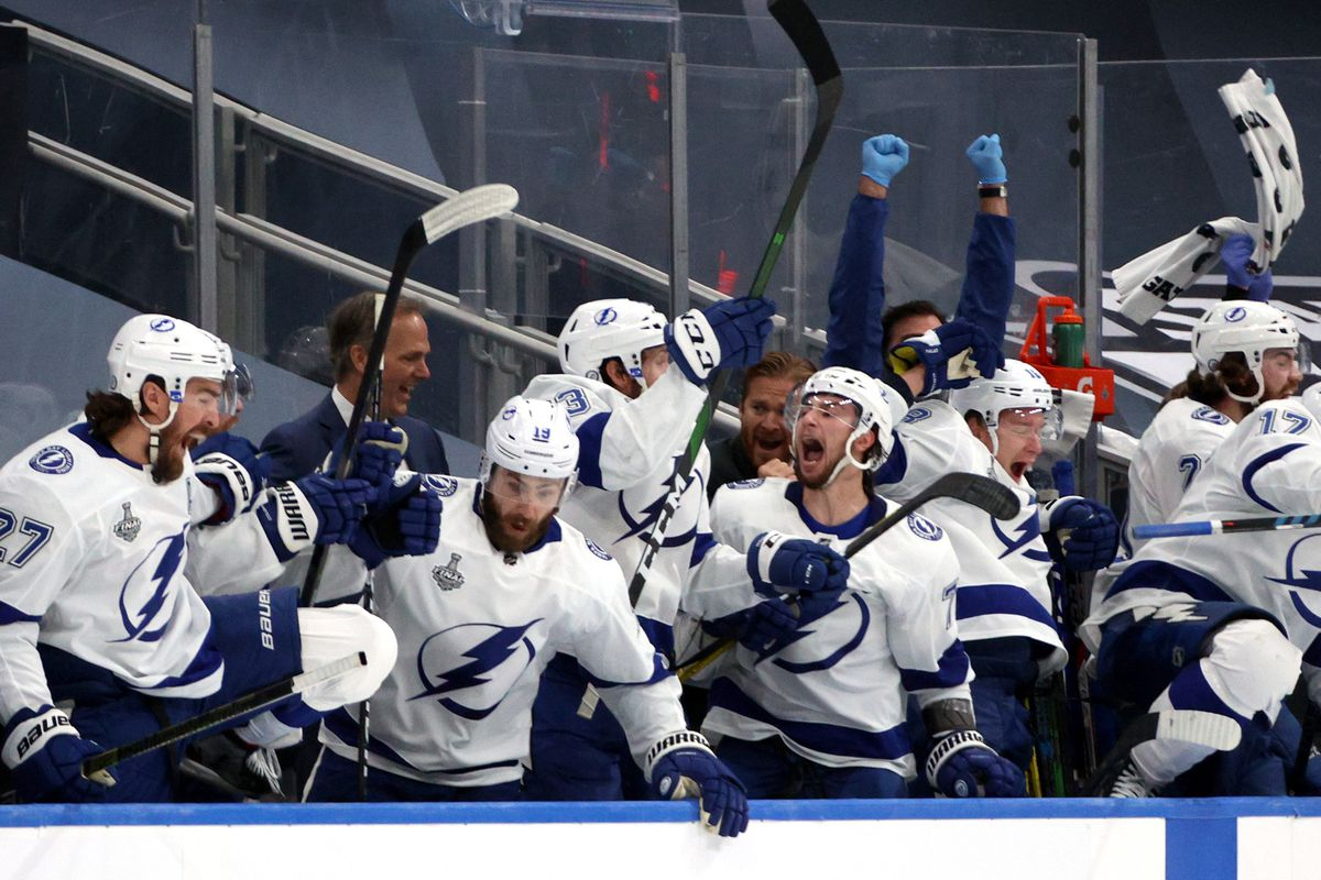 The Tampa Bay Lightning players on the bench react after Kevin Shattenkirk #22 of the Tampa Bay Lightning scored the game-wining goal in the first overtime period of Game Four of the NHL Stanley Cup Final between the Tampa Bay Lightning and the Dallas Stars at Rogers Place on September 25, 2020 in Edmonton, Alberta, Canada. The Lightning defeated the Stars 5-4 in overtime.