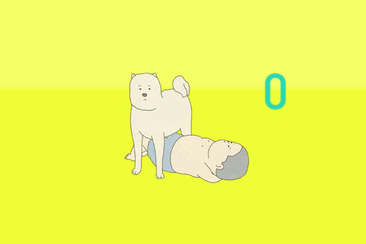 A boy prepares to do a sit-up into a big dog