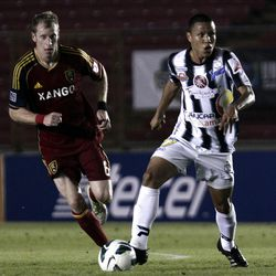 Panama's Tauro FC Ruben Martinez, right, is chased by U.S. Real Salt Lake Nat Borchers, left, during a CONCACAF Champions League soccer match in Panama City, Tuesday, Sept. 18, 2012. U.S. Real Salt Lake won 1-0. (AP Photo/Arnulfo Franco)