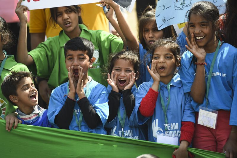 Indian school students shout slogans during a protest against global warming in New Delhi on March 15, 2019.