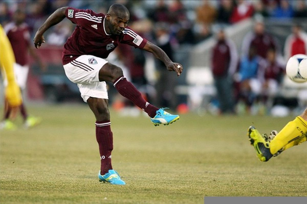 March 10, 2012; Denver, CO, USA; Colorado Rapids Omar Cummings kicks the ball during the second half against the Columbus Crew at the Dick's Sporting Goods Park.  Mandatory Credit: Chris Humphreys-US PRESSWIRE