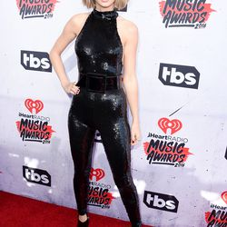 Taylor Swift wears a jumpsuit from Saint Laurent's fall 2016 collection.