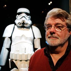 """This is a Saturday, Oct. 22, 2005 file photo of  filmmaker George Lucasas he pauses in front of a Stormtrooper exhibit at the Museum of Science in Boston  prior to the opening of """"Star Wars: Where Science Meets Imagination,""""    The George Lucas empire has struck back against a British prop designer who sold replicas of the iconic Stormtrooper uniforms from the """"Star Wars"""" movies.  Designer Andrew Ainsworth has fought a long legal battle against Lucasfilm Ltd., which sued him over the replica suits and helmets he sold through a Web site.   (AP Photo/Winslow Townson)"""