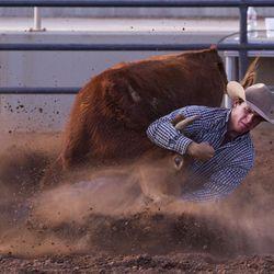 Kelton Cropper wrestles a steer during the Utah High School Rodeo Finals in Heber City on Saturday, June 3, 2017.