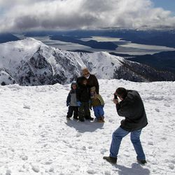 Vacationing Argentines pose for a picture on a mountain in San Carlos de Bariloche, Argentina, Friday, Sept. 21, 2012. Thousands of Argentines began enjoying Friday to make the most of the long weekend, which lawmakers approved just three weeks ago. Monday's Sept. 24th holiday makes for a total of 19 national paid holidays this year. Only Colombia comes close in Latin America, with 18.