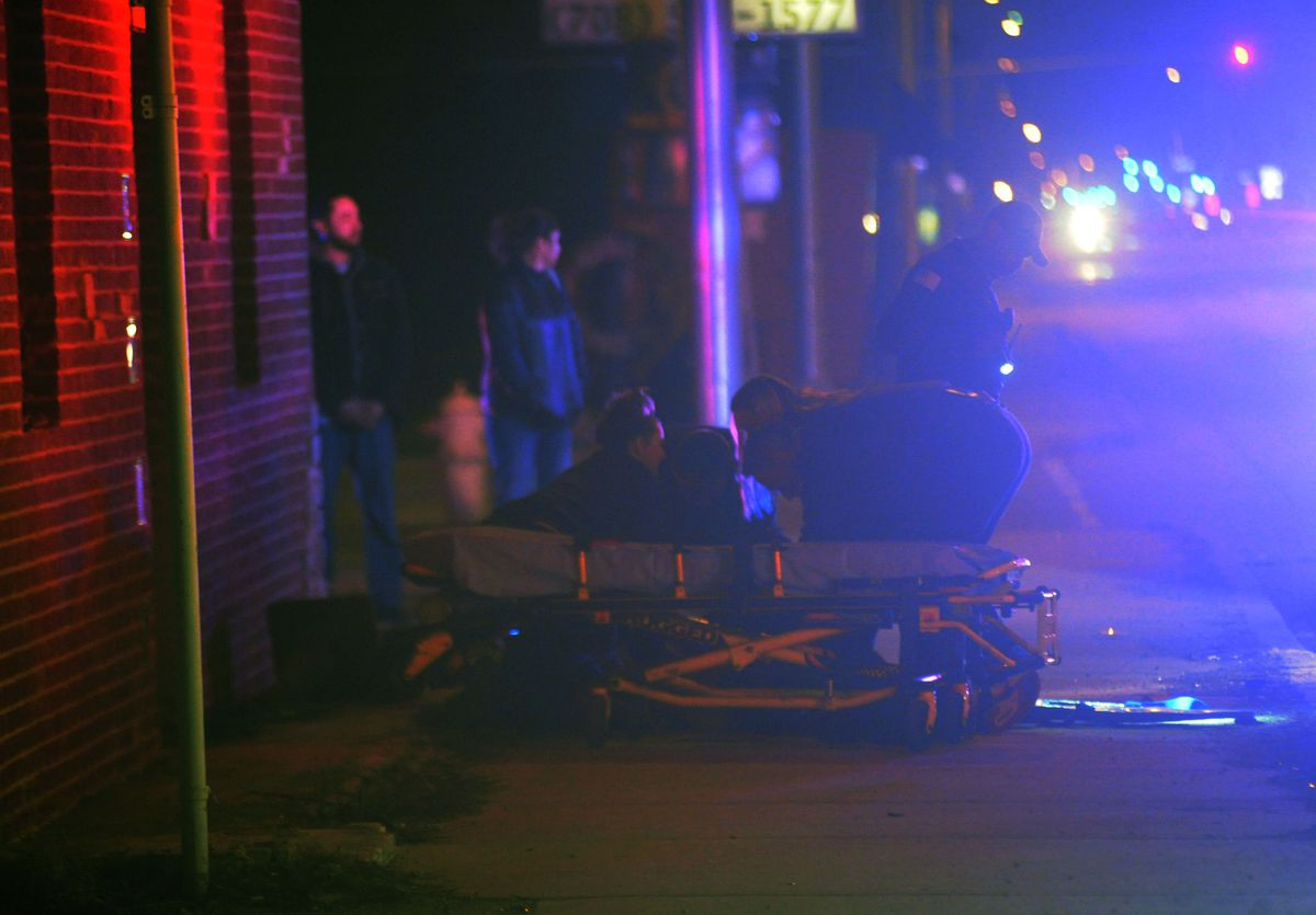 Paramedics respond to a shooting that left two people wounded early Saturday in the 15900 block of Finch Avenue in Harvey. | Justin Jackson/Sun-Times