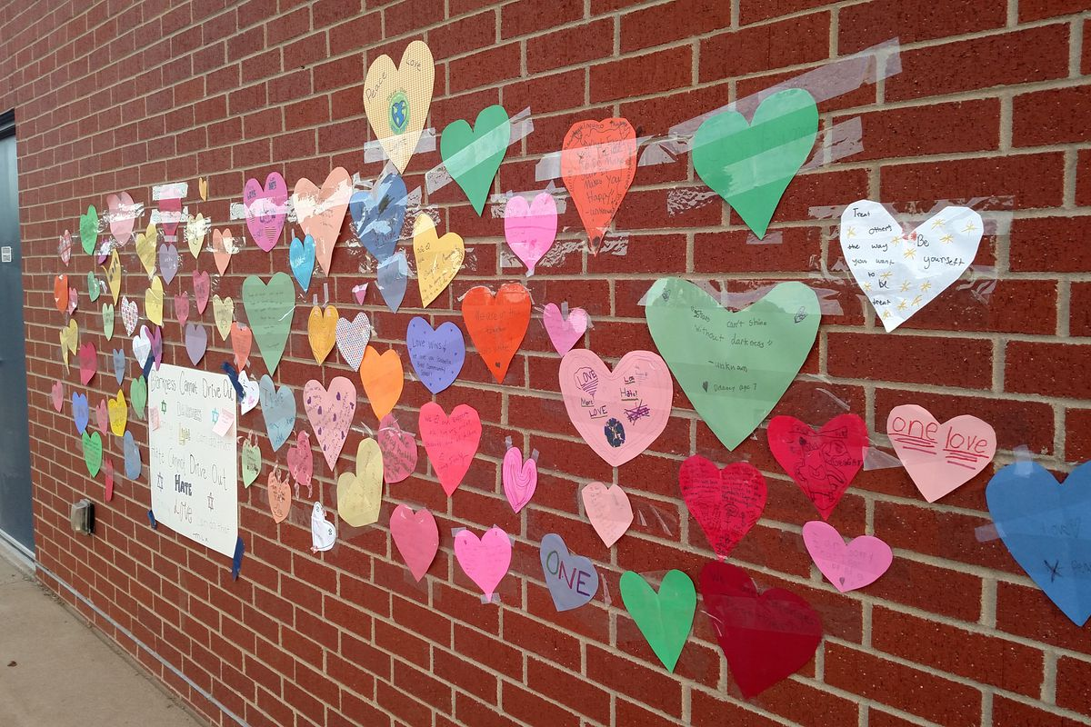 Messages of love that replaced graffiti at Denver's Isabella Bird Community School.
