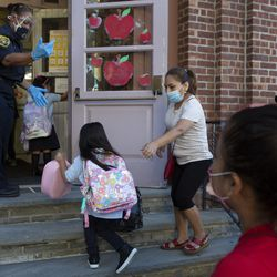 T. Walker helps students at the entrance at the Lafayette School Annex on Tuesday.