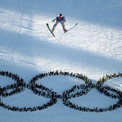 Chil Gu Kang, of Korea, trains on the 90-meter ski jump hill at the Utah Olympic Park on Feb. 6, 2002.