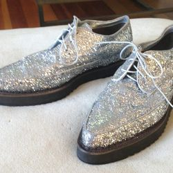 """""""These Costume National silver glitter creepers came straight off the runway and onto my feet. Sample size."""""""