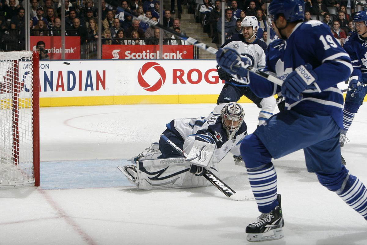 TORONTO, CANADA - OCTOBER 19: Joffrey Lupul #19 of the Toronto Maple Leafs scores on Ondrej Pavelec #31 of the Winnipeg Jets during NHL action at the Air Canada Centre October 19, 2011 in Toronto, Ontario, Canada. (Photo by Abelimages/Getty Images)
