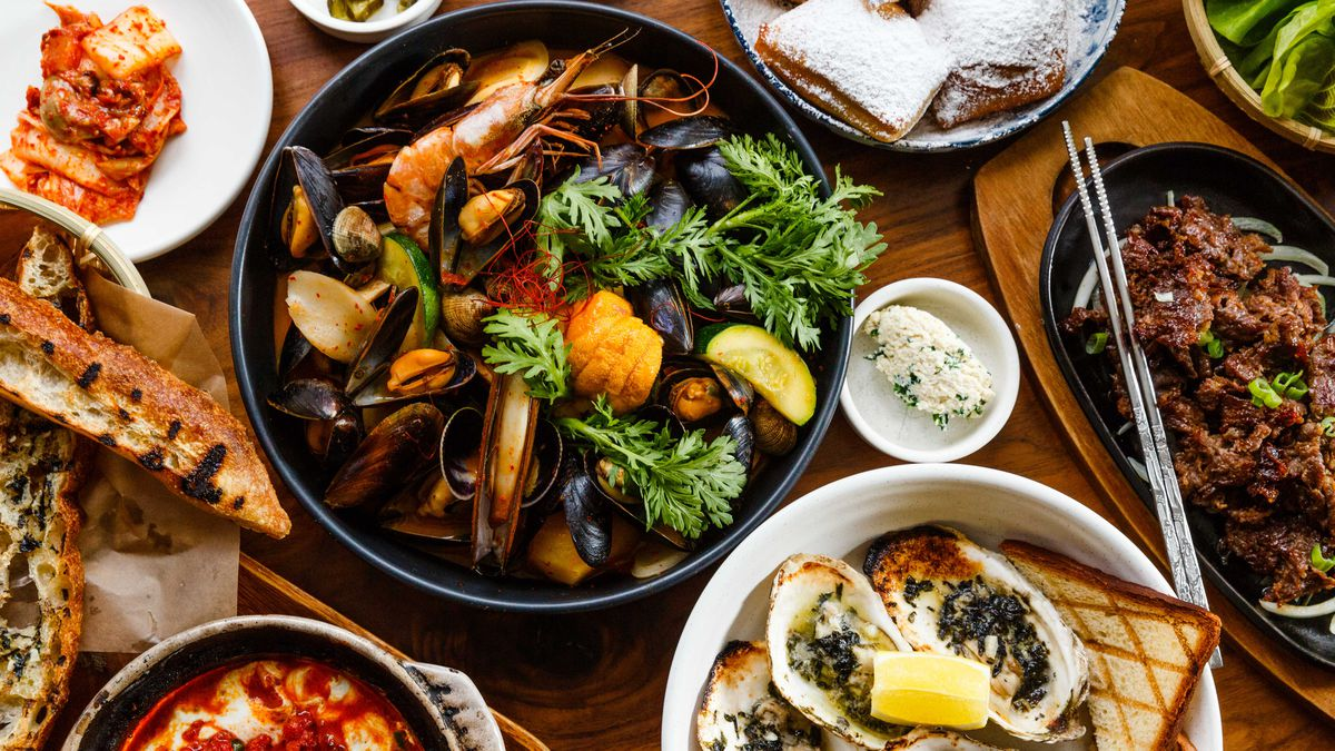 Bouillabaisse and a spread of other dishes at Haenyeo