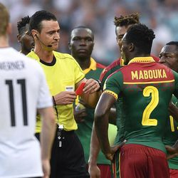 Referee Wilmar Roldan shows a red card to Cameroon's Ernest Mabouka during the Confederations Cup, Group B soccer match between Germany and Cameroon, at the Fisht Stadium in Sochi, Russia, Sunday, June 25, 2017.