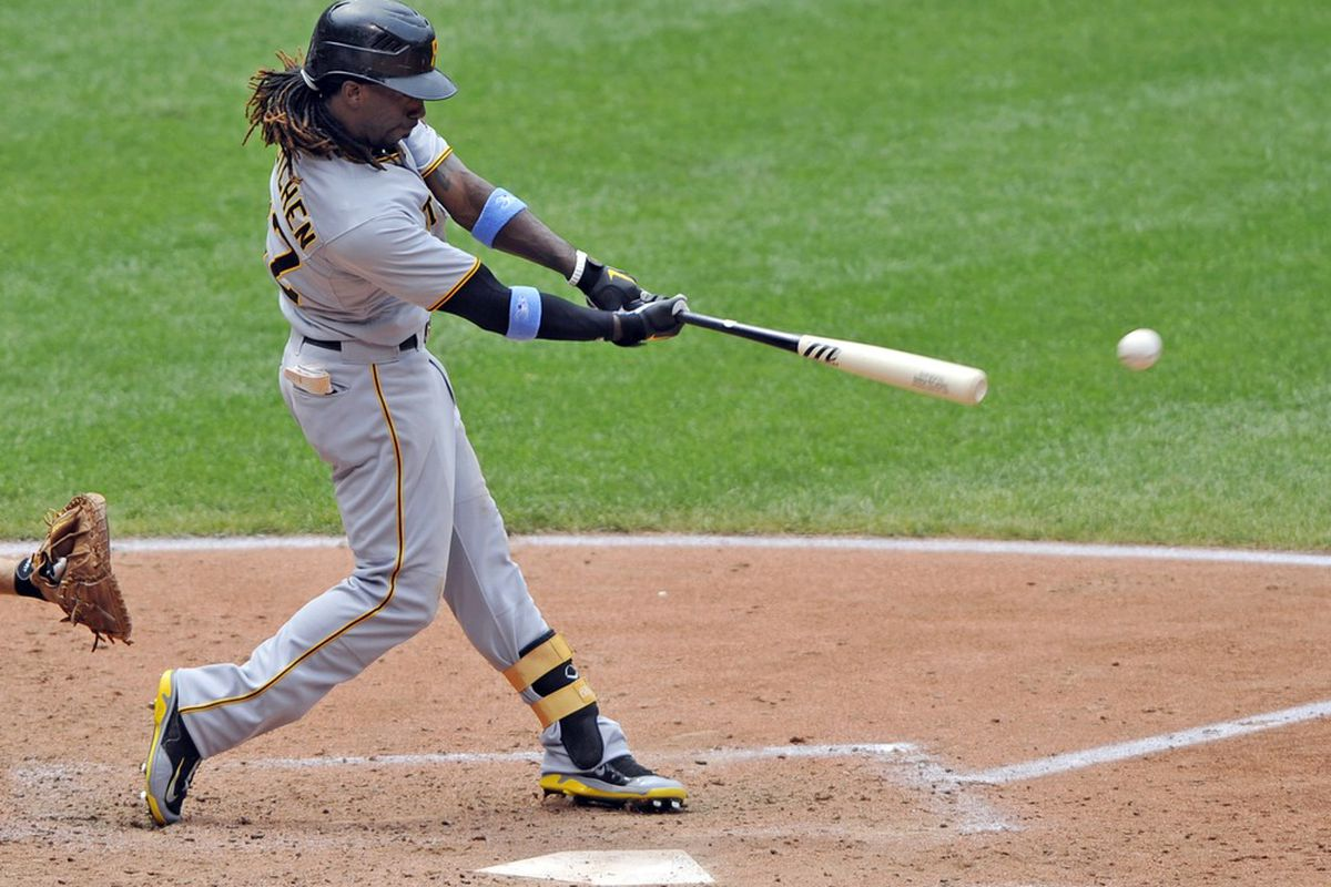 June 17, 2012; Cleveland, OH, USA; Pittsburgh Pirates center fielder Andrew McCutchen (22) hits a ground-rule double in the fifth inning against the Cleveland Indians at Progressive Field. Mandatory Credit: David Richard-US PRESSWIRE
