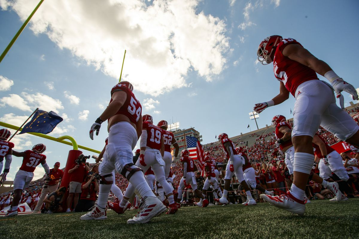 The Indiana University Hoosiers head onto the field to play...