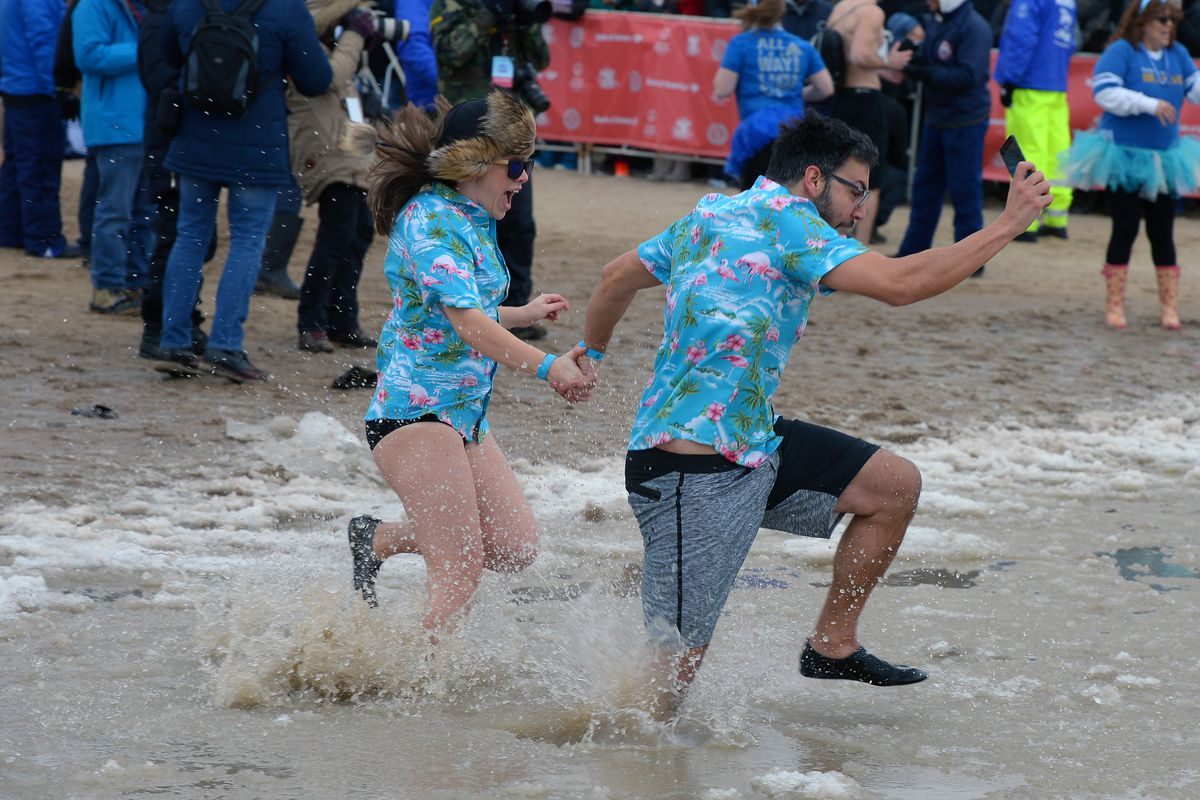 Participants flee the frigid water during the 19th annual Chicago Polar Plunge.