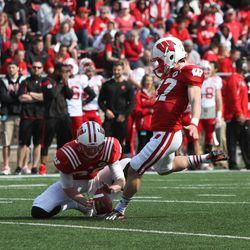 Andrew Endicott attempts a field goal.