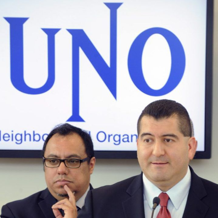 Martin Cabrera Jr. (right) at a May 28, 2013, news conference to announce he was stepping in to replace Juan Rangel (left) as chairman of the United Neighborhood Organization.   Sun-Times files