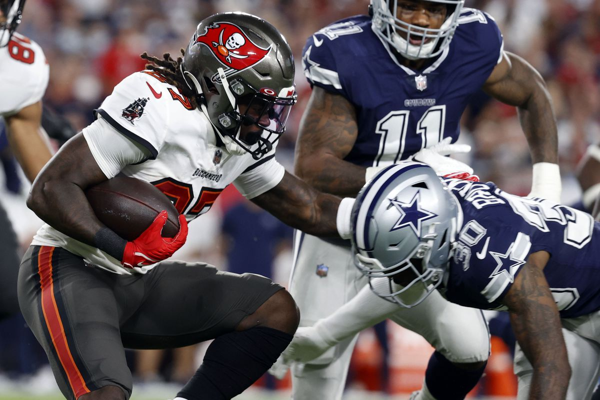 Tampa Bay Buccaneers running back Ronald Jones (27) runs the ball against Dallas Cowboys cornerback Anthony Brown (30) during the first half at Raymond James Stadium.