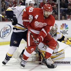 Detroit Red Wings center Henrik Zetterberg (40), of Sweden, controls the puck in front of Nashville Predators defenseman Ryan Suter (20) during the first period of Game 3 of an NHL hockey Stanley Cup first-round playoff series in Detroit, Sunday, April 15, 2012.