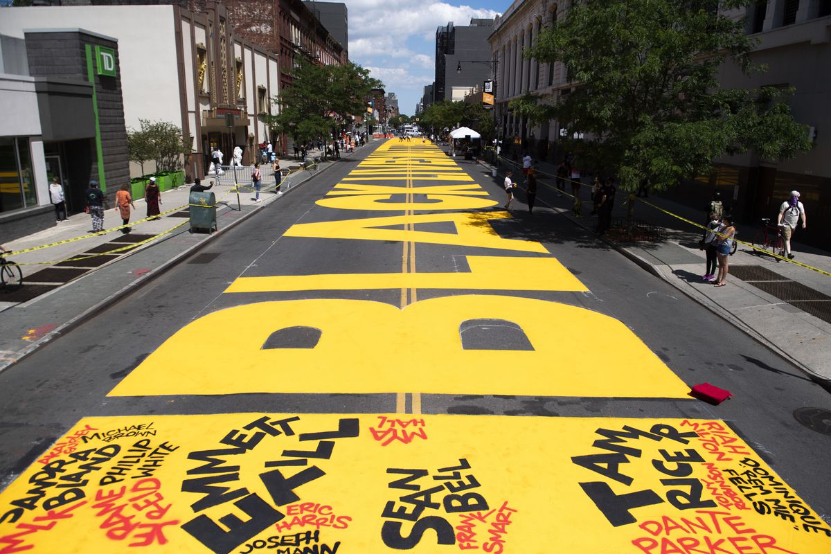 Black Lives Matter spelled out in big, bright yellow lettering on a Brooklyn street.