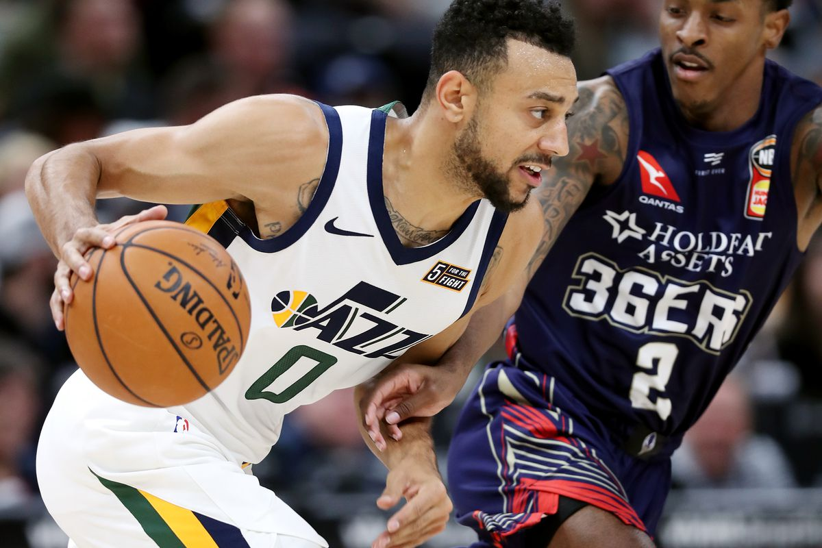 Utah Jazz guard Nigel Williams-Goss (0) is pressured by Adelaide 36ers point guard Deshon Taylor (2) as the Utah Jazz and the Adelaide 36ers play at Vivint Arena in Salt Lake City on Saturday, Oct. 5, 2019.