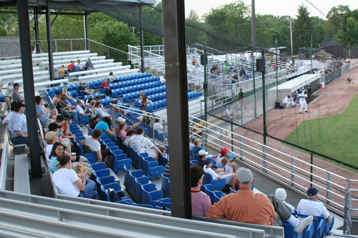 Fans take in a minor league baseball game at Pohlman Field i