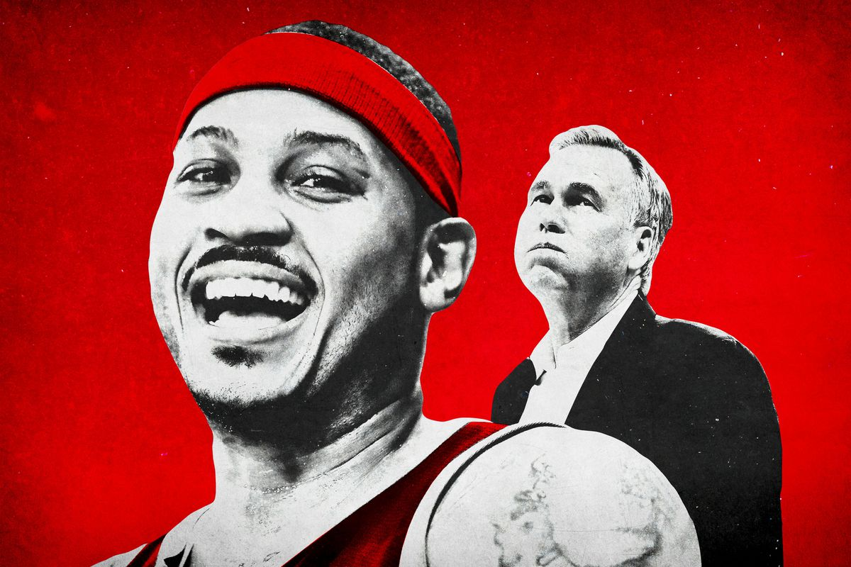 Carmelo Anthony smiling with Mike D'Antoni frowning in the background