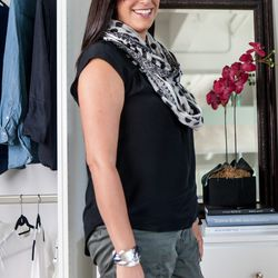 """<b>Anna Putnam, Principal Engineer</b>, wearing Blank NYC pants, a Gillian Julius bracelet, Daniel Rainn top, Anthropologie scarf, and Frye boots. <br> <b>What is your worst shopping habit?</b> <br> """"T-shirts!  Even though I have them in every style a"""